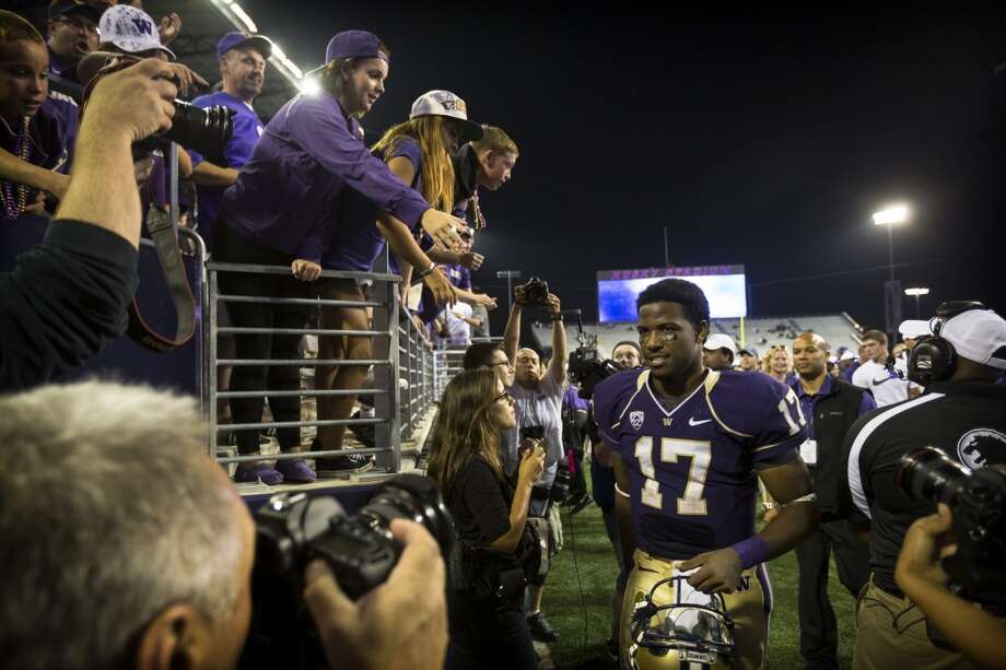 Keith Price leaves the field after beating Boise State at the opening season football game Saturday, August 31, 2013, at the University of Washington's newly-renovated Husky Stadium in Seattle. The Huskies beat Boise State 38-6. (Jordan Stead, seattlepi.com) Photo: JORDAN STEAD, SEATTLEPI.COM