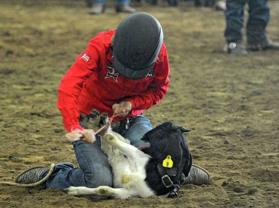 Shayne Vallone, 13, of Ballston Spa competes in the goat tying event in the rodeo at the 172nd Fonda Fair on Tuesday, Aug. 27, 2013 in Fonda, N.Y. (Lori Van Buren / Times Union) Photo: Lori Van Buren, Albany Times Union / 00023650A