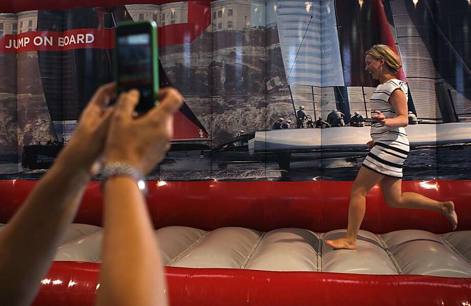 Natalia Turchak photographs her friend Polina Istomina having fun in the Kids' Zone at America's Cup Park at Piers 27-29  in San Francisco. Photo: Liz Hafalia, The Chronicle
