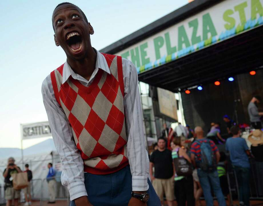 Brenton Weyi laughs after dancing to Michael Jackson's Thriller on the first day of the annual Bumbershoot music and arts festival Saturday, Aug. 31, 2013, at the Seattle Center. Photo: SY BEAN, SEATTLEPI.COM / SEATTLEPI.COM