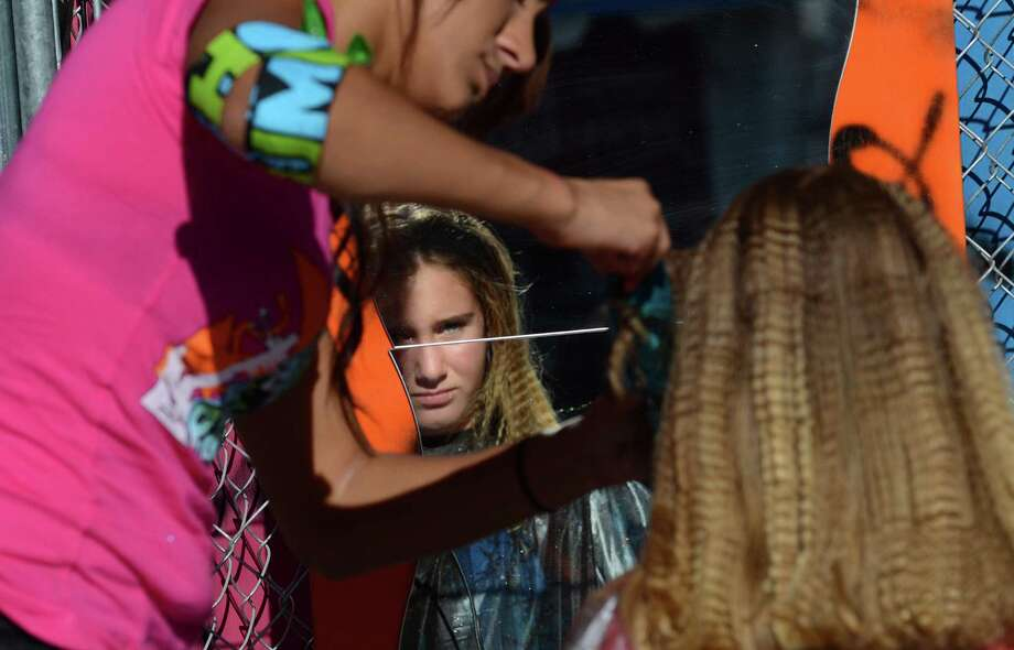 An attendee gets her hair done on the first day of the annual Bumbershoot music and arts festival Saturday, Aug. 31, 2013, at the Seattle Center. Photo: SY BEAN, SEATTLEPI.COM / SEATTLEPI.COM