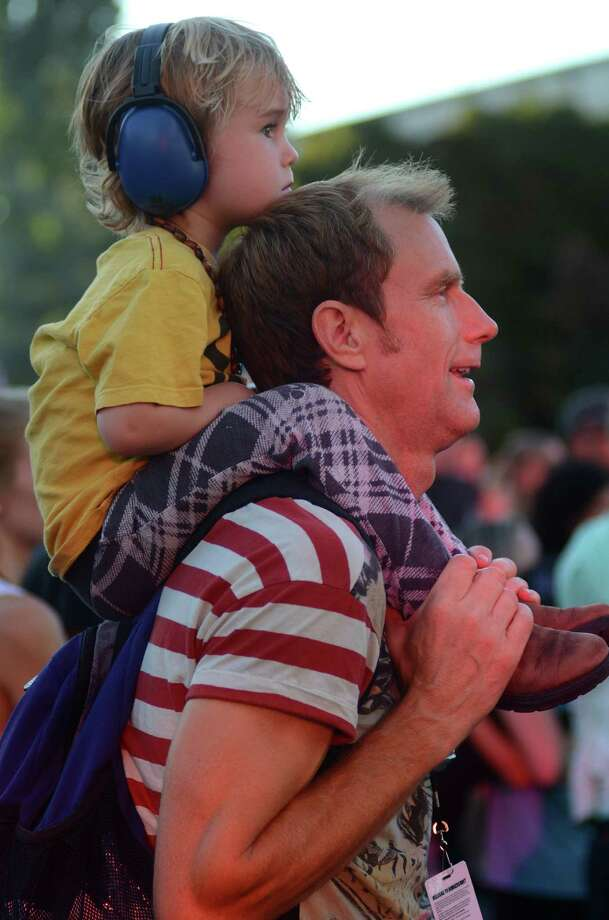 Magnus Porter, rides his father, Swain, as they listen to Lake Street Dive on the first day of the annual Bumbershoot music and arts festival Saturday, Aug. 31, 2013, at the Seattle Center. Photo: SY BEAN, SEATTLEPI.COM / SEATTLEPI.COM