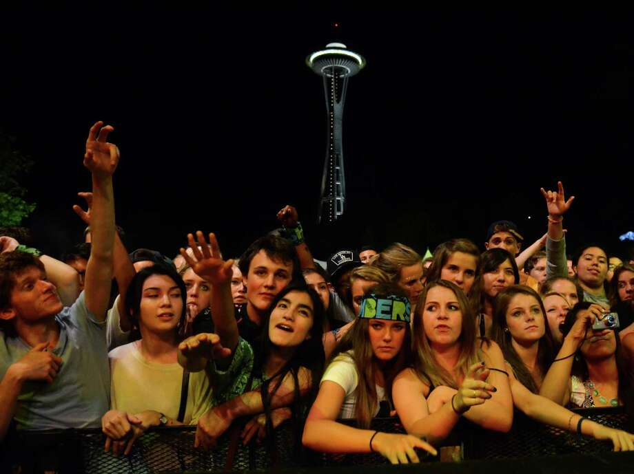Fans waive their arms as Washed Out performs on the first day of the annual Bumbershoot music and arts festival Saturday, Aug. 31, 2013, at the Seattle Center. Photo: SY BEAN, SEATTLEPI.COM / SEATTLEPI.COM