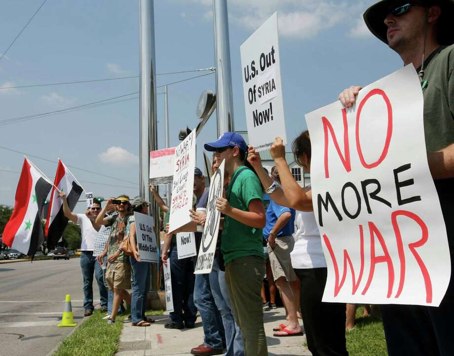 People demonstrate against United States involvement in the conflict in Syria on Saturday, Aug. 31, 2013 in Houston. Photo: AP