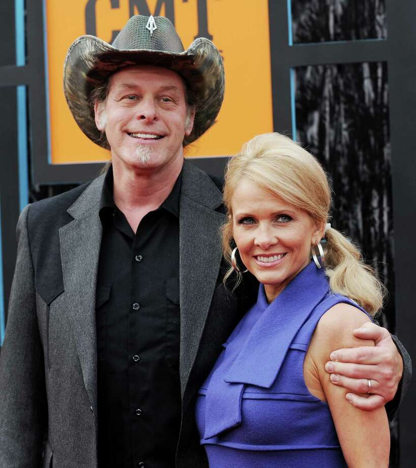 In this June 16, 2009, file photo, musician Ted Nugent and wife, Shemane Ann Nugent, arrive at the CMT Music Awards in Nashville, Tenn. Shemane Nugent has been arrested after a handgun was found in her carry-on luggage at an airport security checkpoint. Dallas/Fort Worth International Airport confirmed that Nugent was taken into custody Thursday, Aug. 29, 2013. Photo: AP