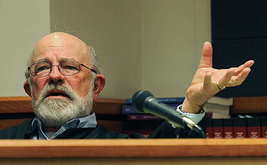 "This undated photo shows District Judge G. Todd Baugh presiding at a hearing in Great Falls, Mont. Protesters are calling for the resignation of Baugh, who said a 14-year-old rape victim was ""older than her chronological age"" and had ""as much control of the situation"" as her rapist. Photo: AP"