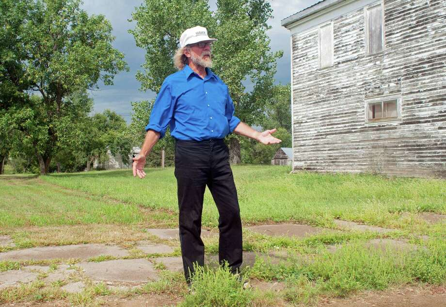 In this Aug. 26, 2013, photo Craig Cobb stands in an empty lot he owns on Main Street in Leith, N.D., where he envisions a park _ perhaps with a swimming pool _ dedicated to the late neo-Nazi and white supremacist activist William L. Pierce. Cobb, 61, a self-described white supremacist, has purchased about a dozen lots in Leith and over the past year he has invited fellow white supremacists to move there and help him to transform the town of 16 people into a white enclave. No one has come, but the community is mobilizing to fight out of fear that Cobb could succeed, and the mayor has vowed to do whatever it takes to ensure Cobb's dream remains just that. Photo: AP