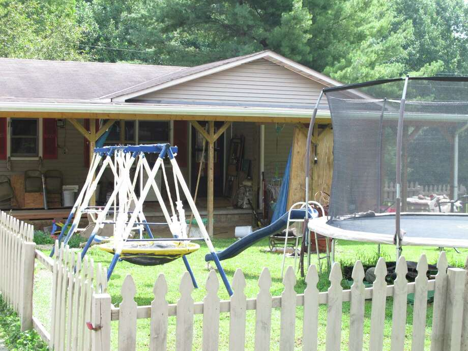 Playground equipment sits outside the home near London, Ky., Thursday, Aug. 29, 2013, where Ernest Chris Chumbley says he fatally shot his wife because she asked him to end her suffering from terminal cancer. Chumbley called 911 Wednesday just minutes after shooting his 44-year-old wife, Virginia Chumbley. Photo: AP
