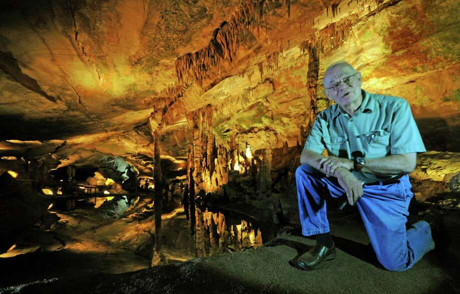 John Jones, owner of Sequoyah Caverns and Ellis Homestead in Valley Head, Ala,, kneels Thursday Aug. 30, 2013,  in a section of the cave called the grand ballroom, which has hosted weddings and other events. The attractions are scheduled to close after the Labor Day holiday. The caverns have been a popular tourist destination since 1964. Thursday, Aug. 29, 2013. Photo: AP