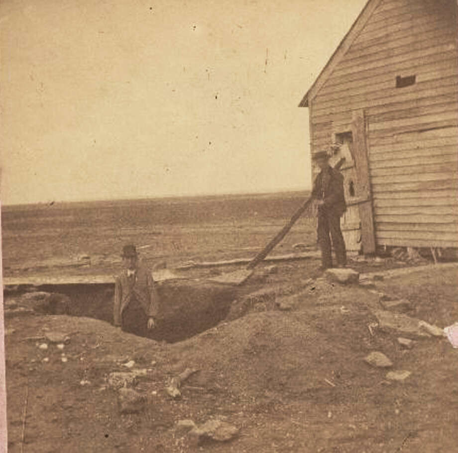 This 1873 photo provided by the Kansas State Historical Society via The Wichita Eagle shows the excavated grave of a victim of the Bender murders in Cherryvale, Kan. The grave was found under a trap door at the Bender house. Ghost hunters wanted to set up their equipment on the scene of serial murders that happened 140 years ago. Photo: AP