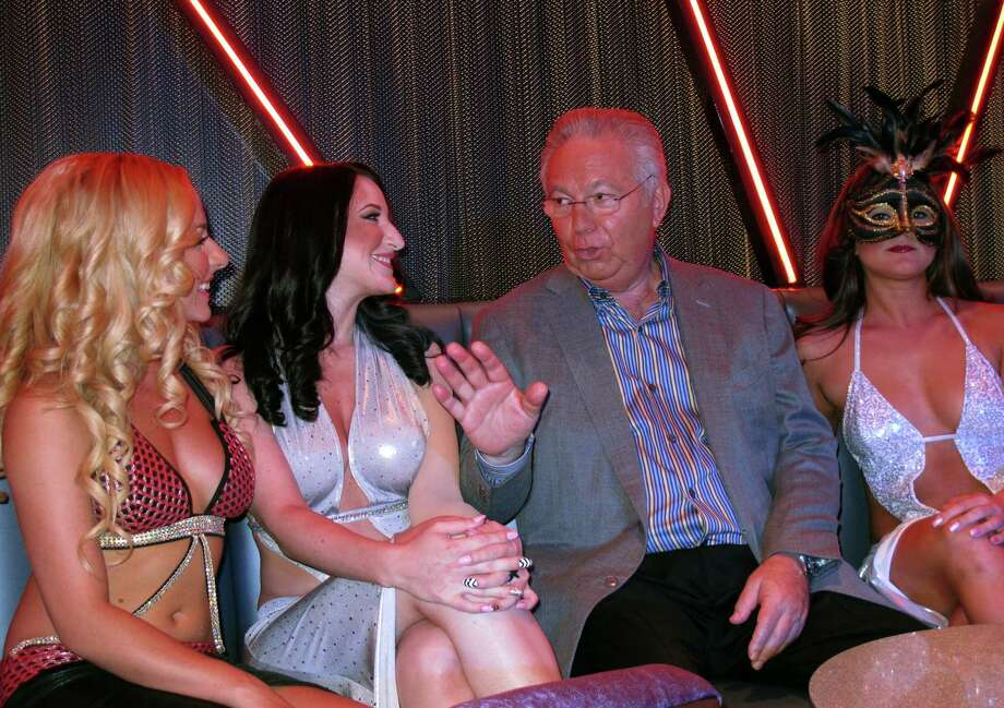 Dancers at Scores listen to club owner Bob Gans, third from left, discuss plans on Monday, Aug. 26, 2013, for the Atlantic City, N.J. strip club's opening next month inside the Taj Mahal Casino Resort. It will mark the first time in 35 years of legalized gambling in New Jersey that a strip club has opened within a casino. Photo: AP