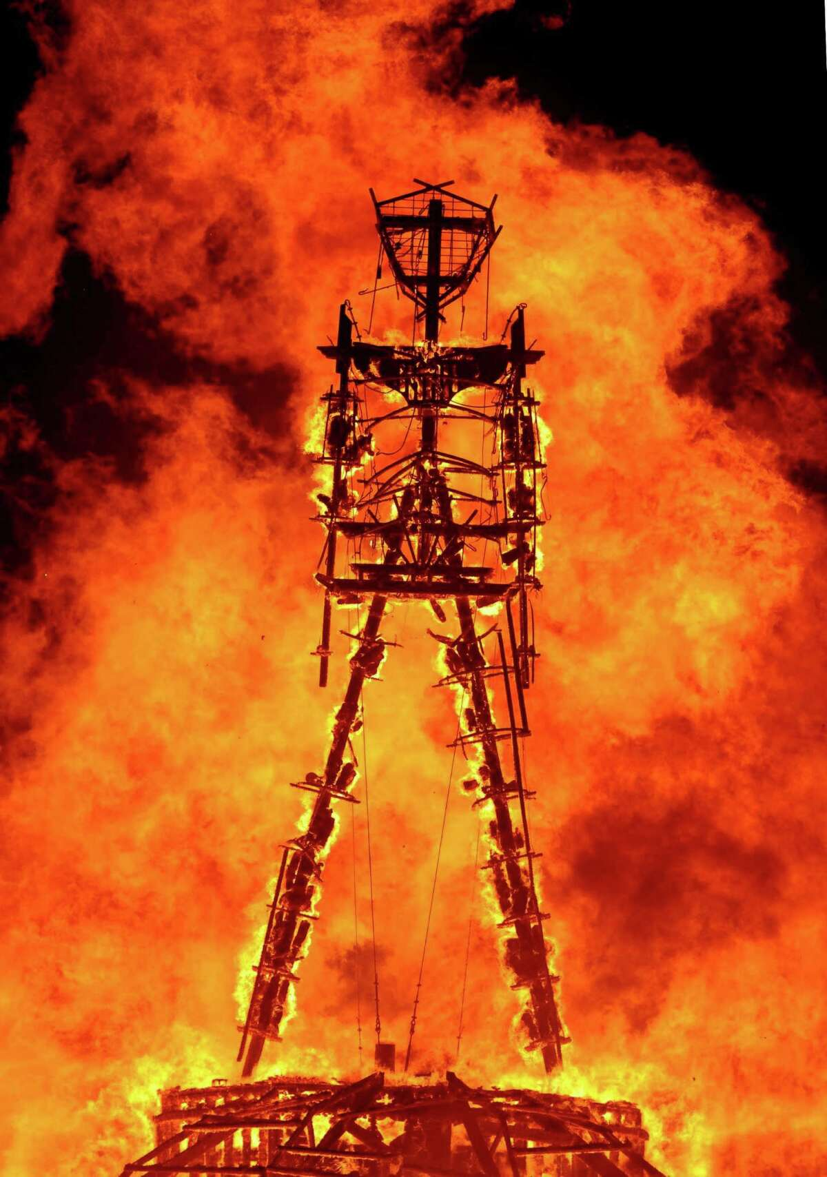 """The """"Man"""" burns on the Black Rock Desert at Burning Man near Gerlach, Nev. on August 31, 2013.U.S. Bureau of Land Management spokesman Mark Turney said Saturday more than 61,000 people have turned out so far for the weekend Burning Man outdoor art and music festival in the Black Rock Desert of northern Nevada. (AP Photo/Reno Gazette-Journal, Andy Barron)"""