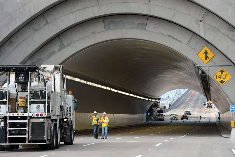 Workers finish up sandblasting and power washing the Yerba Buena Island tunnel on the new eastern span of the Bay Bridge in Oakland, California, Sunday September 1, 2013. Photo: Michael Short, Special To The Chronicle