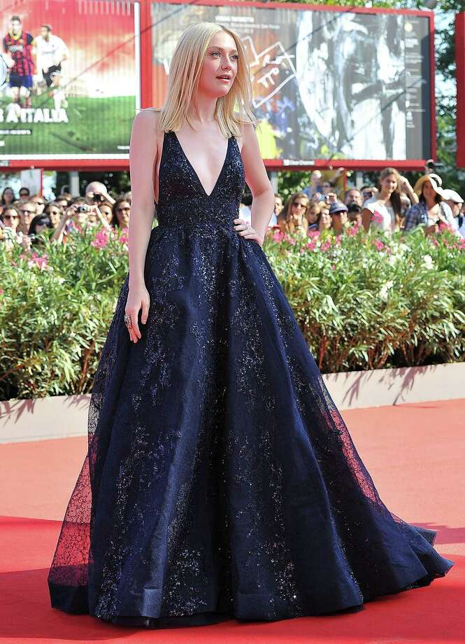 VENICE, ITALY - AUGUST 31:  Actress Dakota Fanning attends 'Night Moves' Premiere during the 70th Venice International Film Festival at the Palazzo del Cinema on August 31, 2013 in Venice, Italy.  (Photo by Stefania D'Alessandro/WireImage) Photo: Stefania D'Alessandro, Getty Images / 2013 Stefania D'Alessandro