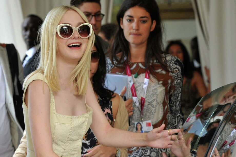US actress Dakota Fanning leaves the Excelsior Hotel during the 70th Venice Film Festival on August 31, 2013.    AFP PHOTO / TIZIANA FABI Photo: TIZIANA FABI, Getty Images / 2013 AFP