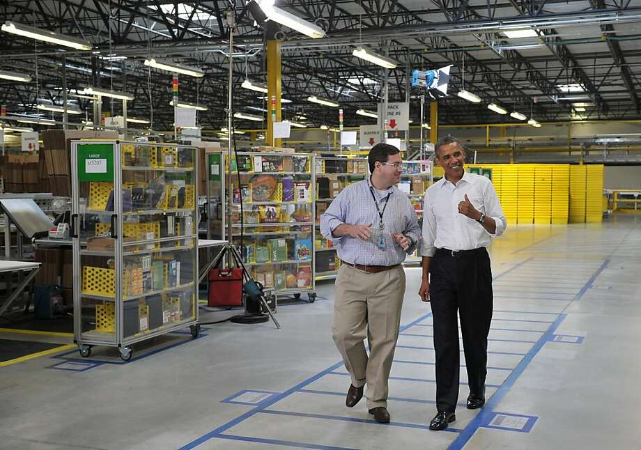 President Obama tours the fulfillment center in Chattanooga, Tenn., with Amazon's Dave Clark in July. Photo: Mandel Ngan, AFP/Getty Images