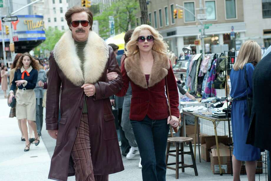 "This film publicity image released by Paramount Pictures shows Will Ferrell as Ron Burgundy, left, and Christina Applegate as Veronica Corningstone in a scene from ""Anchorman 2: The Legend Continues."" Photo: AP"