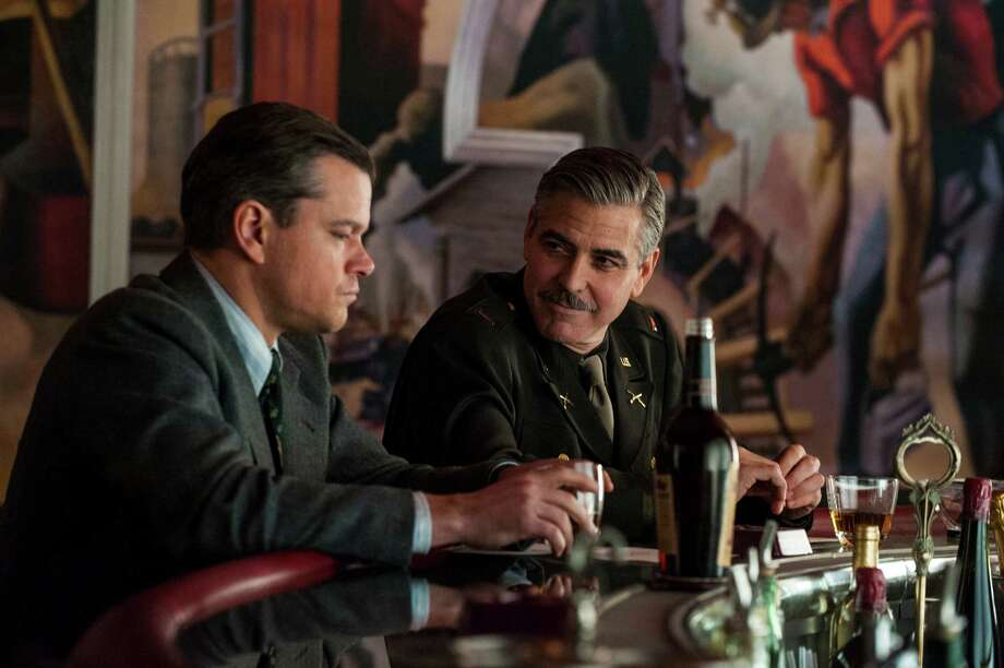 "This film image released by Columbia Pictures shows Matt Damon, left, and George Clooney in ""The Monuments Men."" Photo: AP"