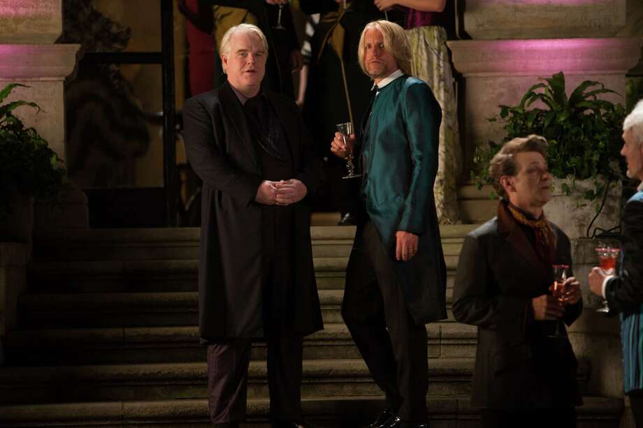 "This film image released by Lionsgate shows Philip Seymour Hoffman, left, and Woody Harrelson in a scene from ""The Hunger Games: Catching Fire."" Photo: AP"
