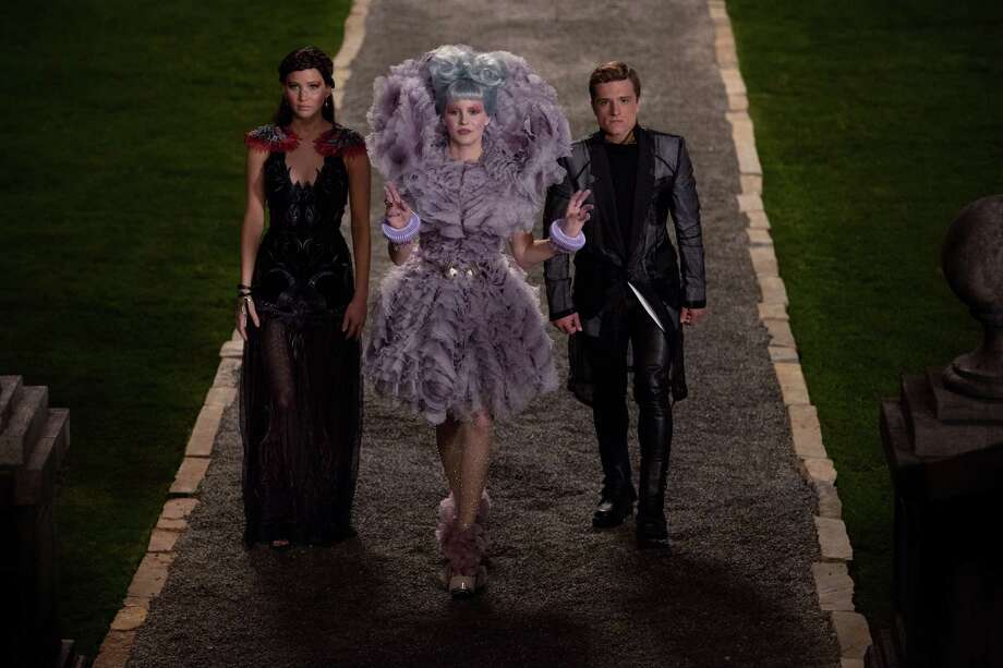 """This film image released by Lionsgate shows, from left, Jennifer Lawrence, Elizabeth Banks, and Josh Hutcherson in a scene from """"The Hunger Games: Catching Fire."""" Photo: AP"""