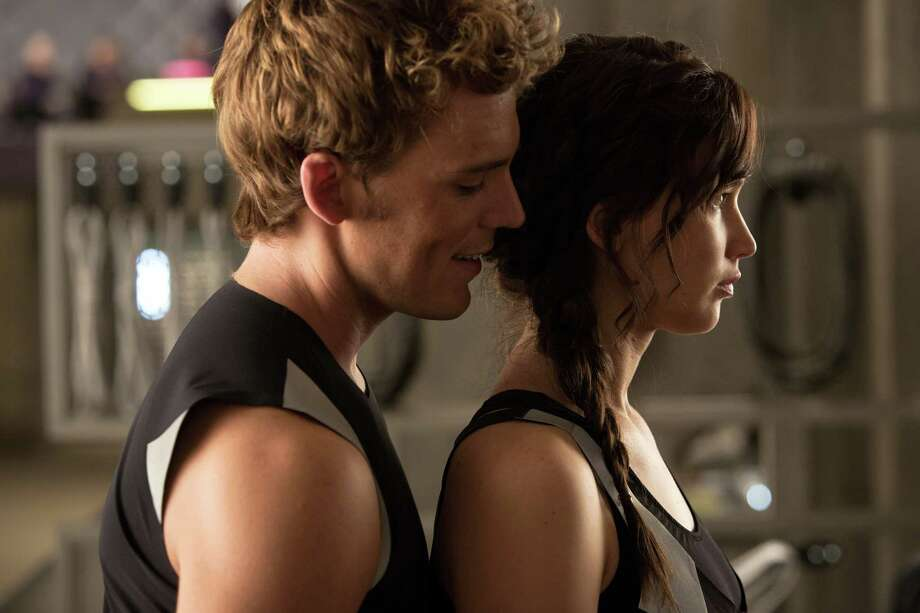 """This film image released by Lionsgate shows Sam Claflin, left, and Jennifer Lawrence in a scene from """"The Hunger Games: Catching Fire."""" Photo: AP"""