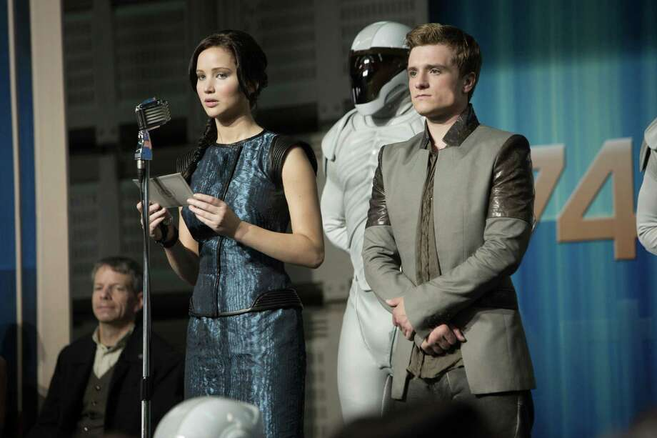 "This film image released by Lionsgate shows Jennifer Lawrence, left, and Josh Hutcherson in a scene from ""The Hunger Games: Catching Fire."" Photo: AP"