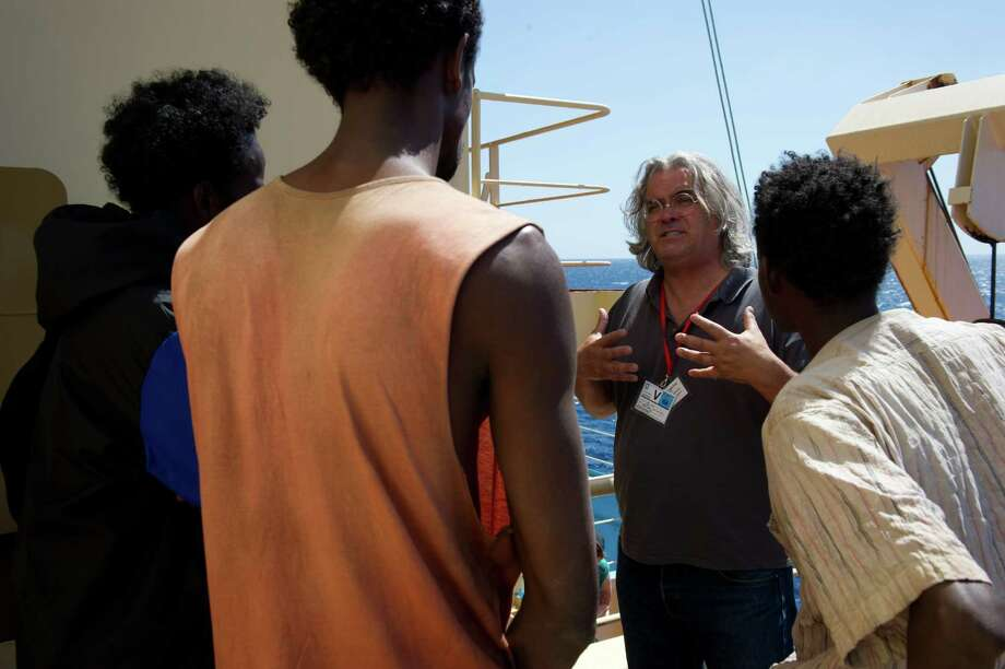 "This film image released by Sony - Columbia Pictures shows director Paul Greengrass during the filming of ""Captain Phillips."" Photo: AP"
