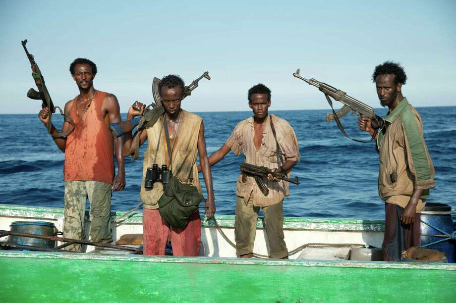"This film image released by Sony - Columbia Pictures shows, from left, Faysal Ahmed, Barkhad Abdi, Barkhad Abdirahman, and Mahat Ali in ""Captain Phillips."" Photo: AP"