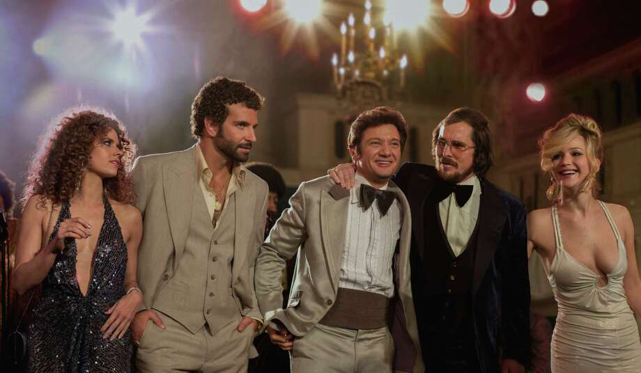 "This film image released by Sony Pictures shows, from left,  Amy Adams, Bradley Cooper, Jeremy Renner, Christian Bale and Jennifer Lawrence in a scene from ""American Hustle."" Photo: AP"