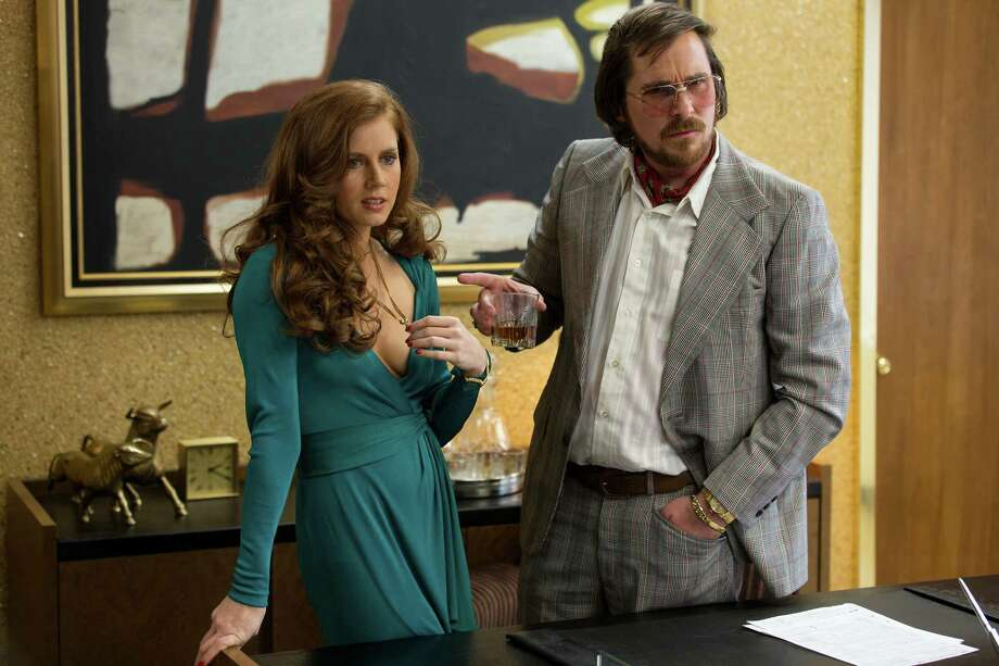 "This film image released by Sony Pictures shows Amy Adams, left, and Christian Bale in a scene from ""American Hustle."" Photo: AP"