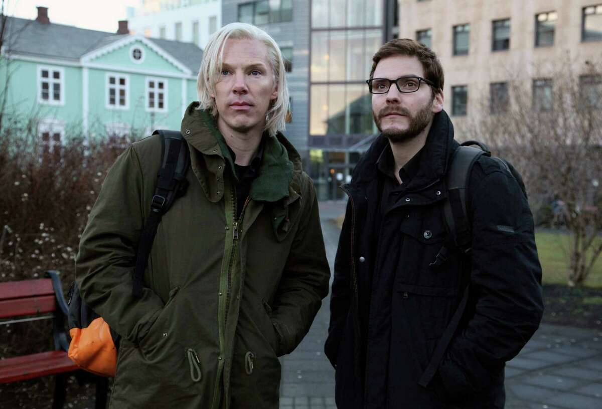 FILE - This undated file photo provided by DreamWorks Studios shows Benedict Cumberbatch, as Julian Assange, left, with Daniel Bruhl, as Daniel Domscheit-Berg, in the WikiLeaks drama,