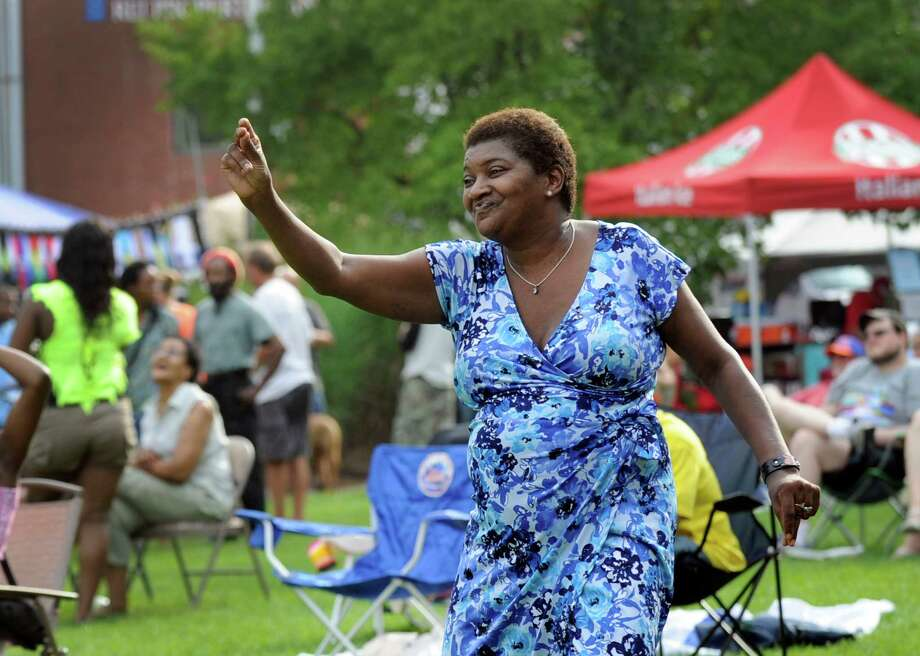 Marilyn Davis of Danbury dances to the music at the The Caribbean Jerk Festival held on the CityCenter Green in Danbury, Conn., Sunday, Sept. 1, 2013. Photo: Carol Kaliff / The News-Times