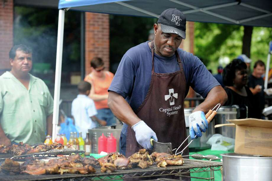 Owen Fowler of Danbury mans a grill at the Caribbean Jerk Festival  held on the CityCenter Green in Danbury, Conn., Sunday, Sept. 1, 2013. Photo: Carol Kaliff / The News-Times