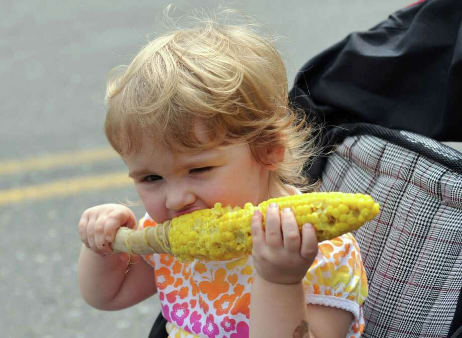 Cassidy Greene, 2 1/2, eats an ear of corn at the Caribbean Jerk Festival on the CityCenter Green in Danbury, Conn., Sunday, Sept. 1, 2013. Photo: Carol Kaliff / The News-Times