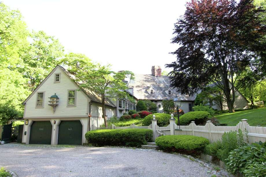 The Colonial at 119 Cross Ridge Road in New Canaan has more than 5,000 square feet, 12 rooms and sits on more than 5 acres of land. It is on the market for $$2,450,000. Photo: Contributed