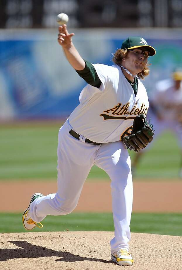 A's starter A.J. Griffin struck out seven in seven innings, and allowed one run - a homer by James Loney. Photo: Thearon W. Henderson, Getty Images