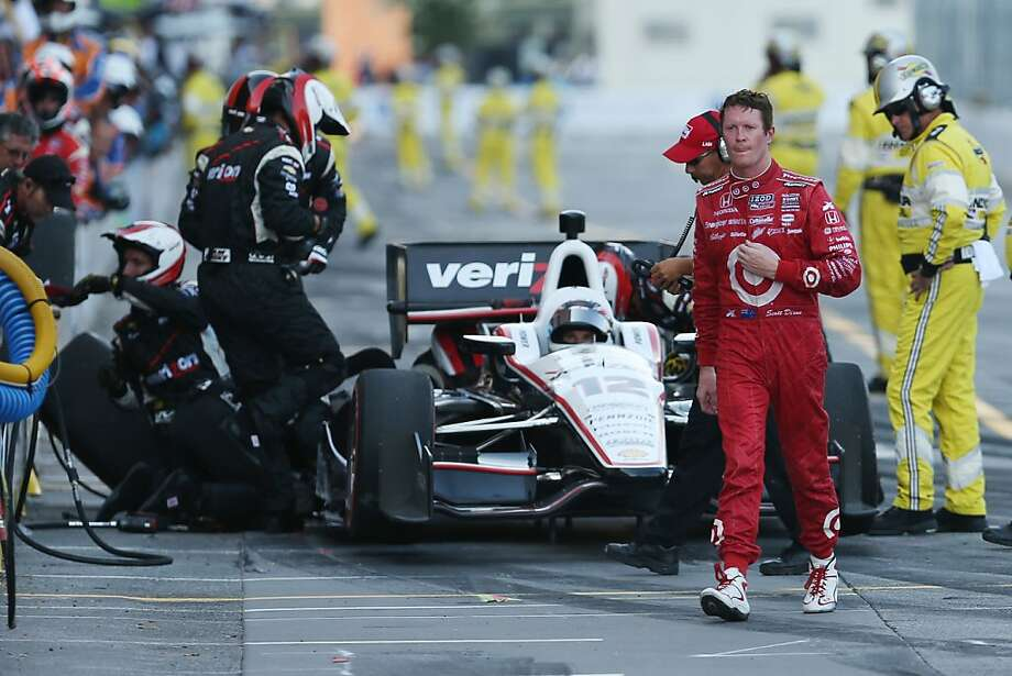 Scott Dixon of New Zealand walks away from Will Power of Australia after a collision knocked  Dixon out of the IndyCar Baltimore Grand Prix. Photo: Rob Carr, Getty Images