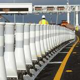 New barricades have been installed to separate fastrak and carpool lanes from from the regular cash lanes near the toll plaza of the Bay Bridge in Oakland, California, Sunday September 1, 2013.