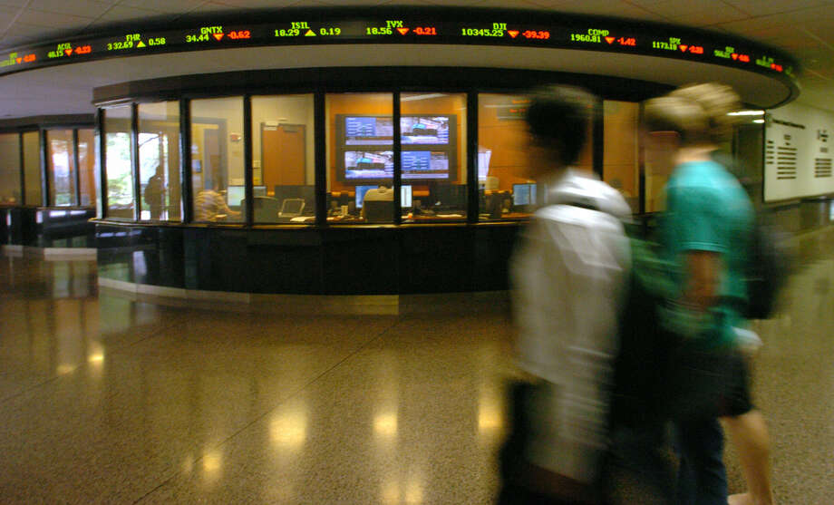 The EDS trading center in the Red McCombs School of Business at UT-Austin. Business students should augment their skills with courses in statistics and cost/benefit analysis. Photo: Helen L. Montoya / San Antonio Express-News