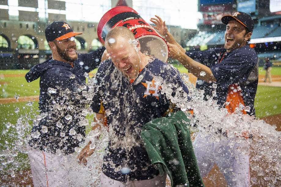 Sept. 1: Astros 2, Mariners 0Astros starting pitcher Brett Oberholtzer is doused by his teammates after pitching a complete game shutout against the Seattle Mariners. Photo: Smiley N. Pool, Houston Chronicle
