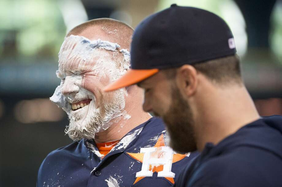 Astros starting pitcher Brett Oberholtzer smiles after getting a towel of shaving cream to the face from pitcher Dallas Keuchel. Photo: Smiley N. Pool, Houston Chronicle