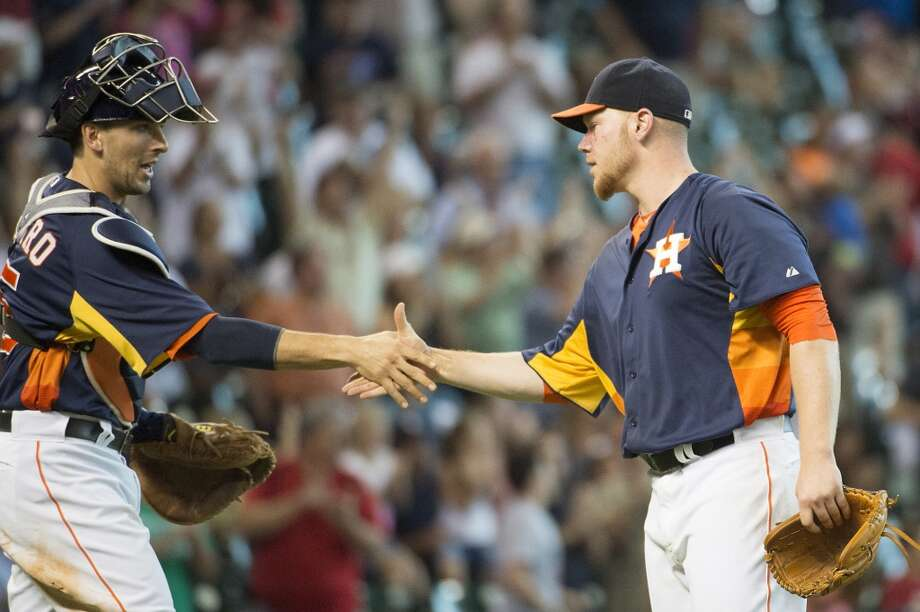 Astros pitcher Brett Oberholtzer is congratulated by catcher Jason Castro after the final out. Photo: Smiley N. Pool, Houston Chronicle