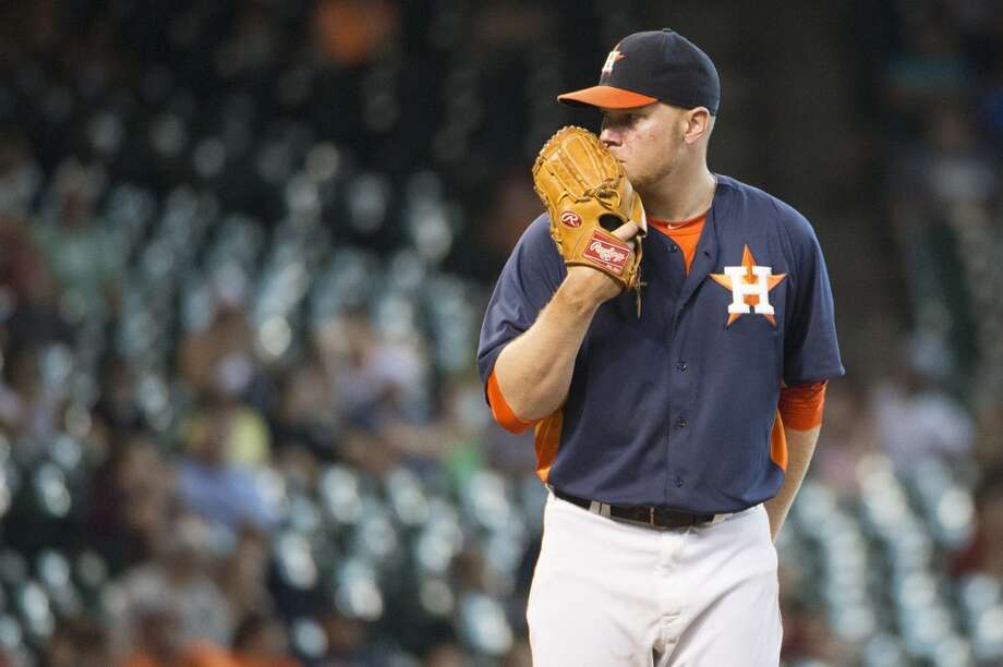 Brett Oberholtzer looks for a sign as he pitches in the ninth inning. Photo: Smiley N. Pool, Houston Chronicle