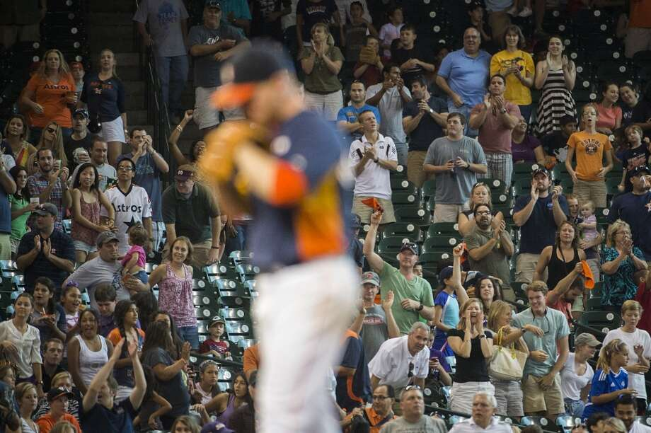 Fans cheer  Brett Oberholtzer as he takes the mound in the ninth inning of a complete game shutout. Photo: Smiley N. Pool, Houston Chronicle