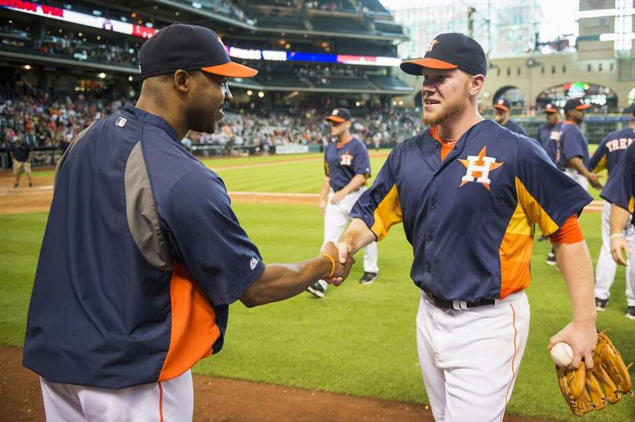 Brett Oberholtzer is congratulated by manager Bo Porter after the shutout. Photo: Smiley N. Pool, Houston Chronicle