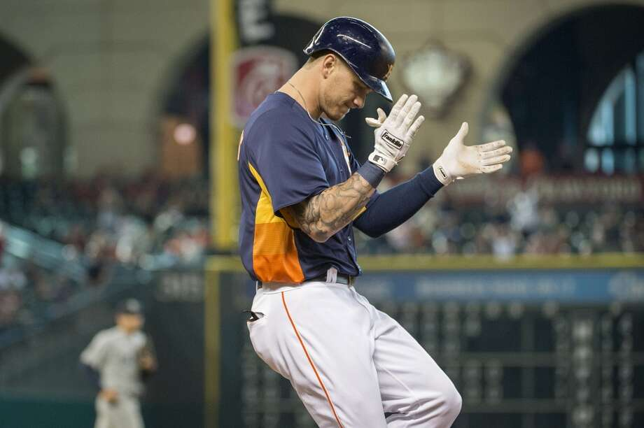 Astros pinch hitter Brandon Barnes celebrates on his way to first base after he put down a bunt to score Jason Castro from third base during the eighth inning. Photo: Smiley N. Pool, Houston Chronicle