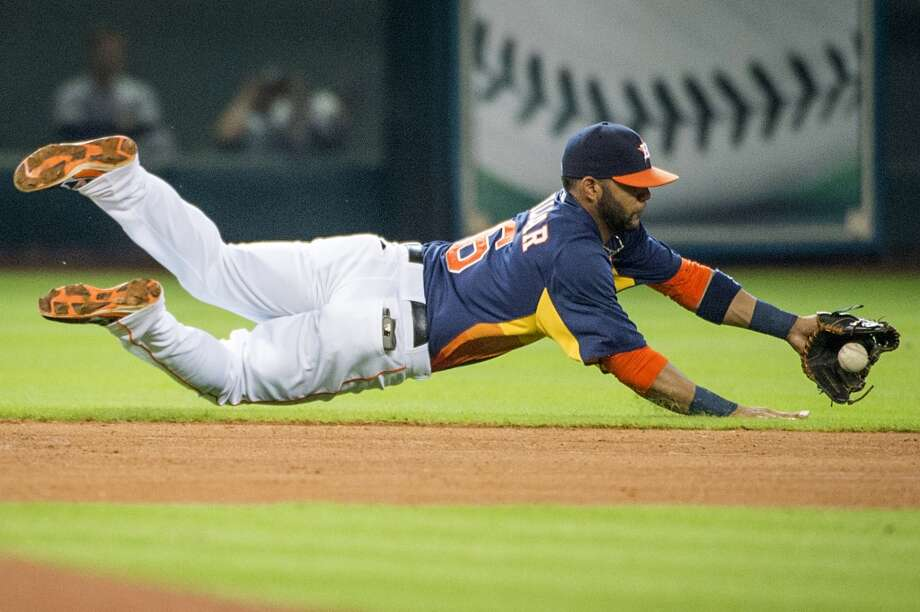Astros shortstop Jonathan Villar dives for a single off the bat of Mariners designated hitter Kendrys Morales during the fourth inning. Photo: Smiley N. Pool, Houston Chronicle