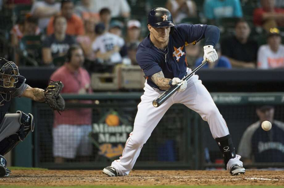 Astros pinch hitter Brandon Barnes puts down a bunt to score Jason Castro from third base during the eighth inning. Photo: Smiley N. Pool, Houston Chronicle