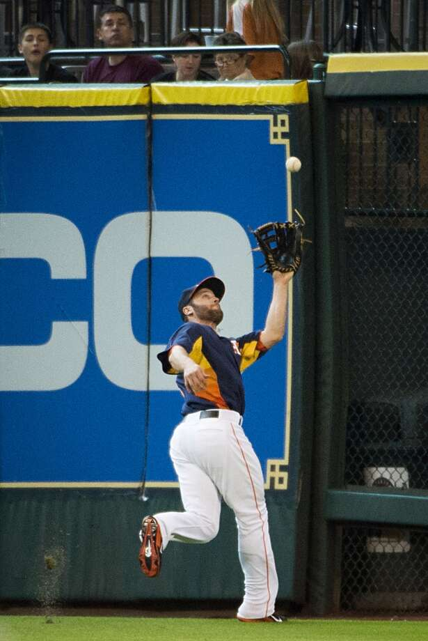 Astros center fielder Trevor Crowe runs down a fly ball by Mariners designated hitter Kendrys Morales on the warning track. Photo: Smiley N. Pool, Houston Chronicle