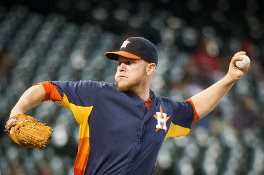 Brett Oberholtzer pitches during the first inning. Photo: Smiley N. Pool, Houston Chronicle
